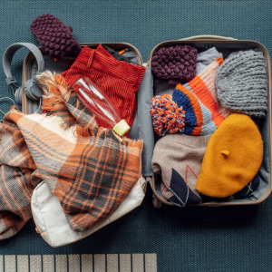 Bag packed with winter items.
