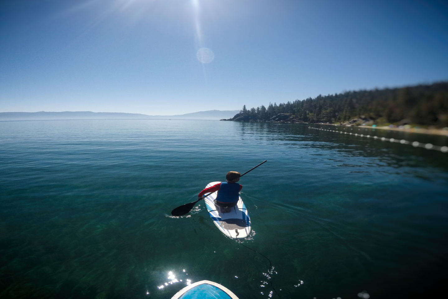 Person stand-up paddleboarding on Lake Tahoe.