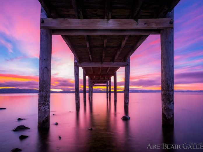 Photo of a dock in North Lake Tahoe with a pink sunset background,